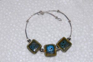 Memory wire bracelet with ceramic square beads