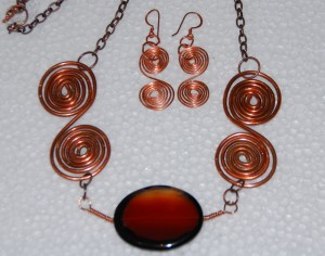 Copper swirls with red agate stone and copper chain