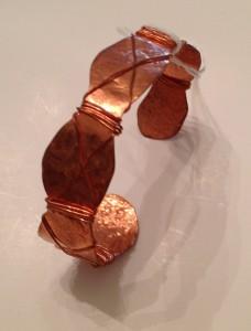 Copper cuff bracelet - swirl cut , hammered, wrapped