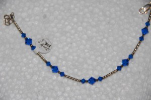 Swarovski sapphire blue 6mm & 4mm, sterling twist tubes.