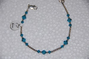 Swarovski blue topaz color crystals, sterling twist tubes.