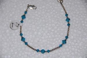 Swarovski blue topaz color crystals, sterling twist tubes.