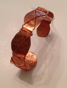 Copper cuff bracelet - swirl cut , hammered, wrapped