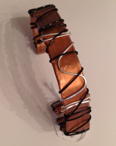 "Copper cuff 1/2 "" wide, hammered and wrapped"